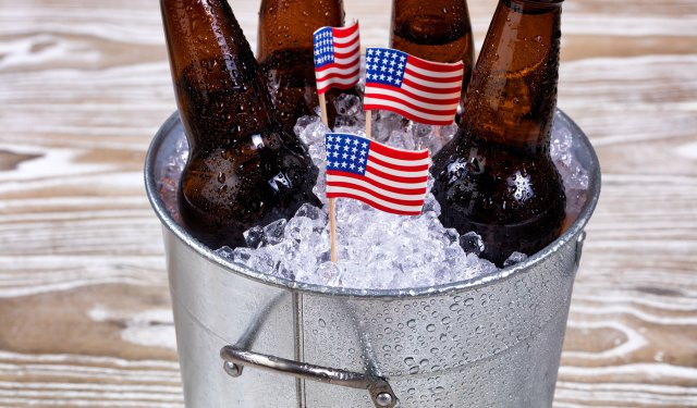 Beer in bucket of ice with American flags