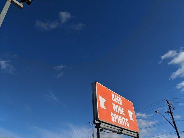 Sign at Ombibulous liquor store