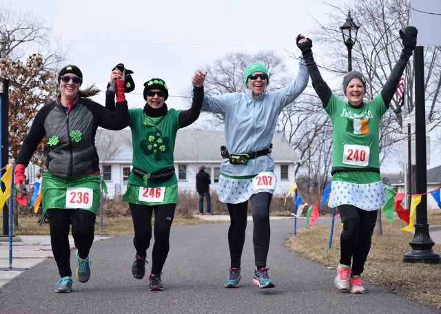 Racers crossing the finish line of Shake Your Shamrock.