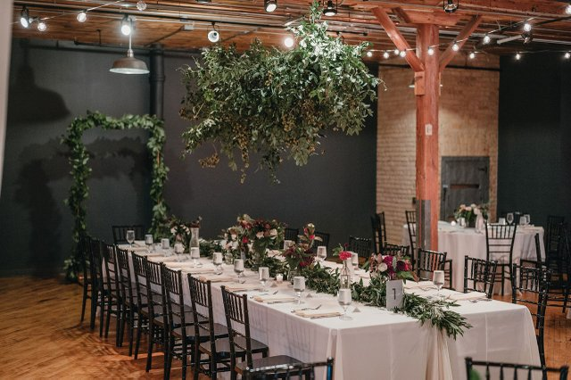 Wedding table with greenery.