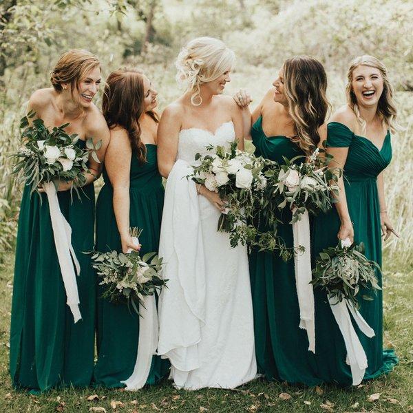 Bridesmaids in green dresses.