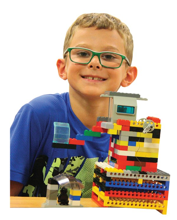 kid playing with legos