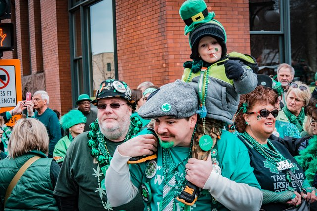 A family decked out in green for St. Patrick's Day.