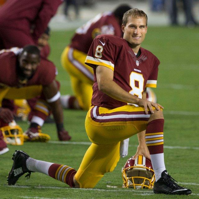 Kirk Cousins kneeling on the field.