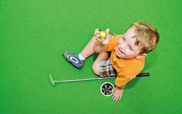 Child mini golfing