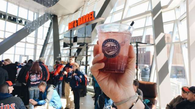 Holding up a drink at Bat & Barrel in Target Field.