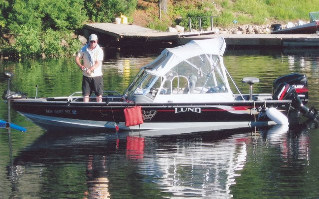 Steve's Dad on motorboat