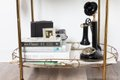 bar cart with antique telephone and cameras