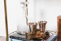 Bar cart with glass decanter and shot glasses