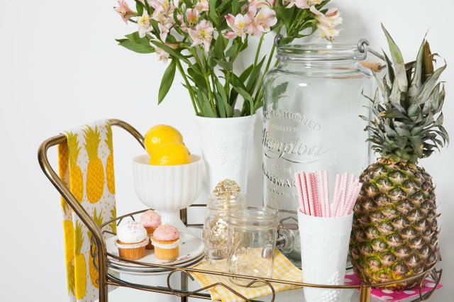bar car with lemons, pineapple, and mini cupcakes