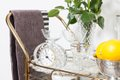 bar cart with antique crystal clock, glassware, and lemons