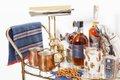 bar cart with copper mugs, pretzels, and liquor bottles