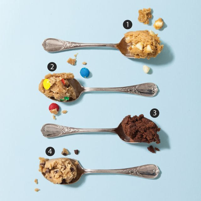 Four spoons full of cookie dough.