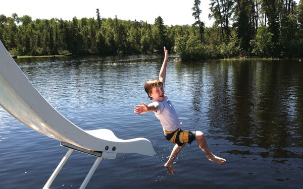 Jumping off houseboat slide
