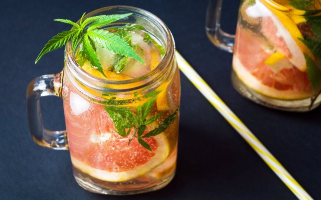 Grapefruit cocktail with marijuana leaf