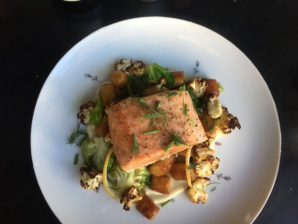 Mercy poached salmon with sweet potato gnocchi, cauliflower, Brussels sprouts by chef Mike Rakun