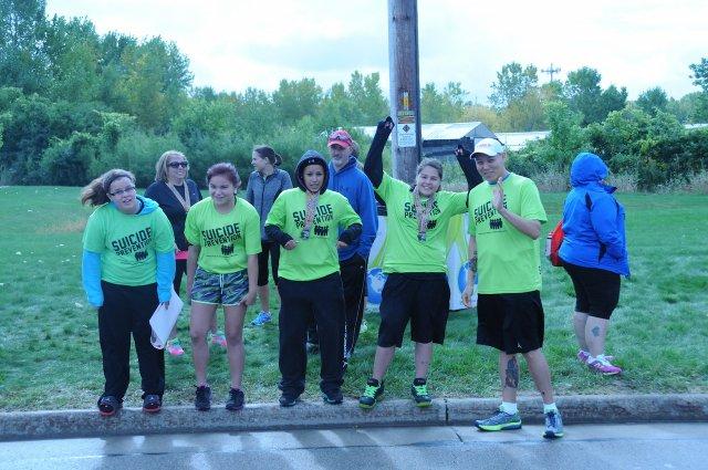 Dirk Whitebreast (far right) participates in a marathon for suicide prevention.