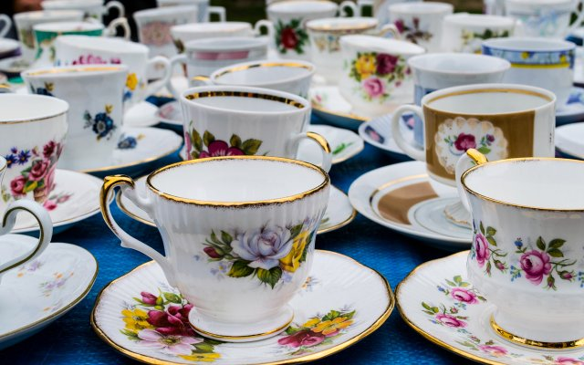 Table full of teacups.