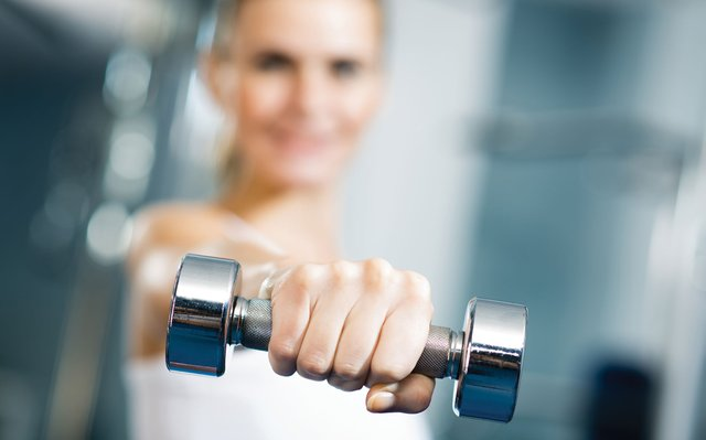 Woman holding small dumbell