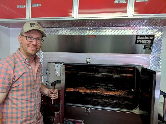 Jon Wipfli with his new BBQ smoker