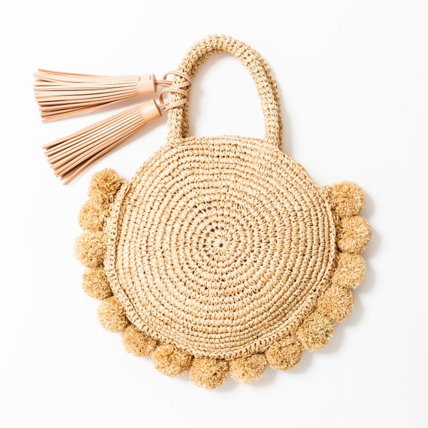 <strong>Straw pom-pom tote</strong> ($295), by Loeffler Randall, from Pumpz & Co., pumpzco.com