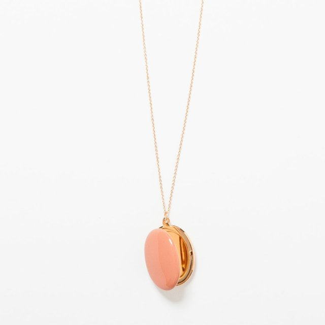 Pink locket on a gold necklace