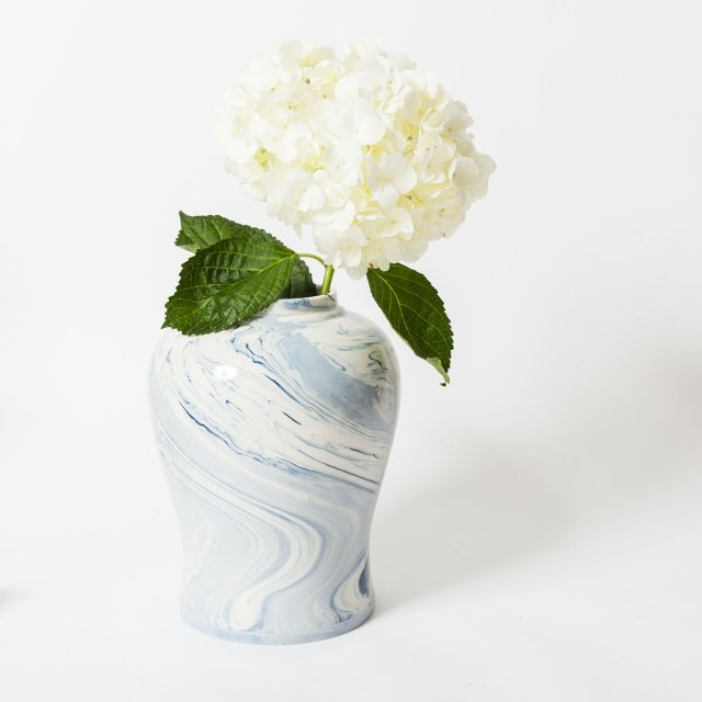 White hydrangea in blue and white painted vase