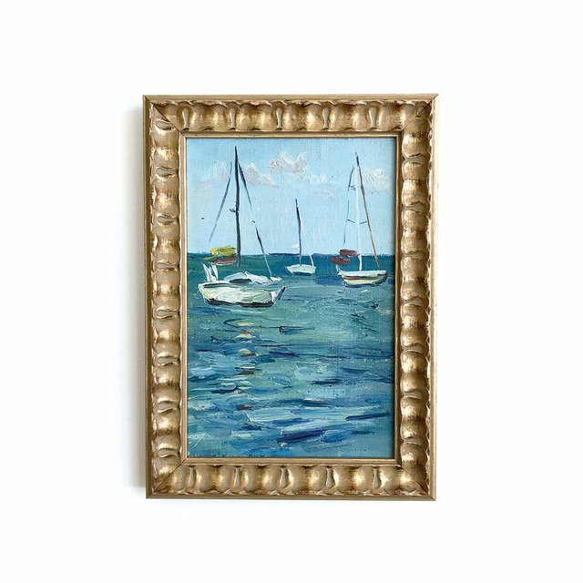 painting of sail boats in a gold frame