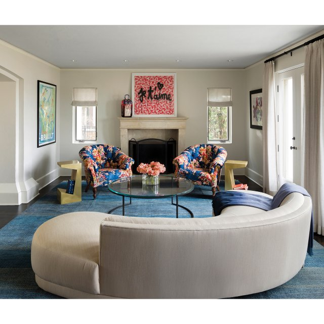 White curved sofa and floral chairs