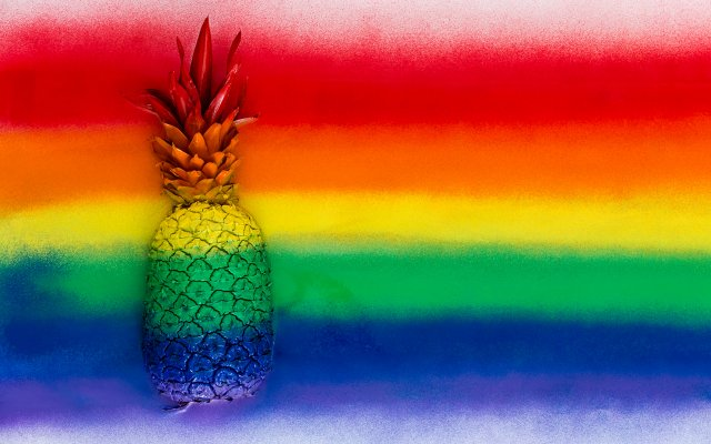 Pineapple spray-painted in rainbow colors.