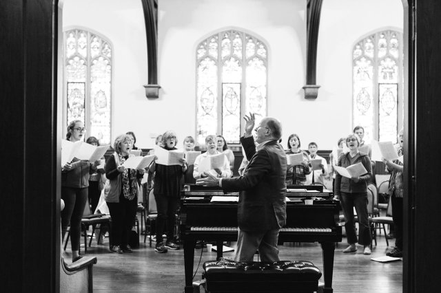 Phillip Brunelle directing choir