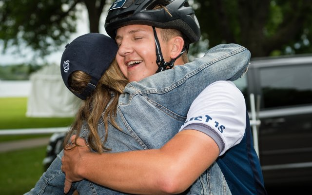 Sam Waldron and his mom hug after his 180-mile Chainbreaker ride