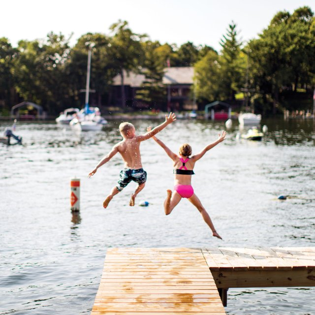 Kids jumping off dock into Lake Minnetonka