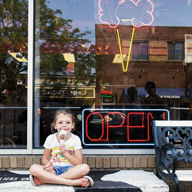 Girl eating ice cream at Licks Unlimited in Excelsior