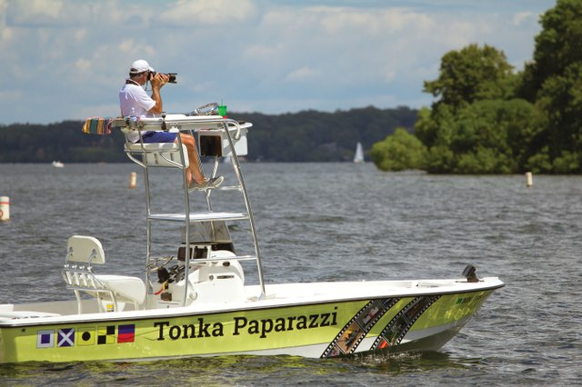 Tonka Paparazzi on boat on Lake Minnetonka