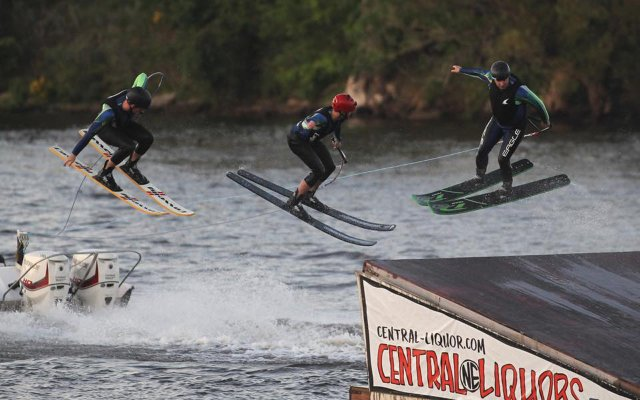 Kyle Zogg and River Rats teammates on a water ski jump.
