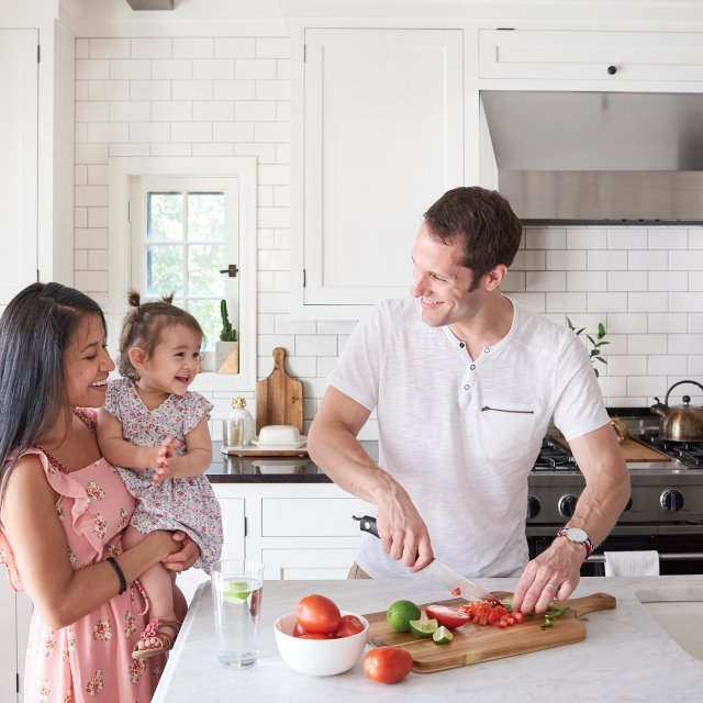Wagner family preparing food in their kitchen