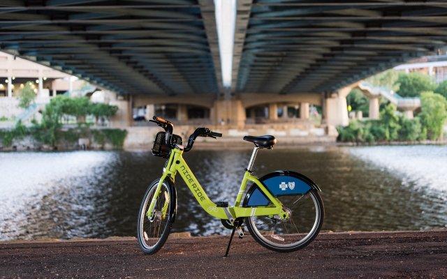 Nice Ride green bike under a bridge