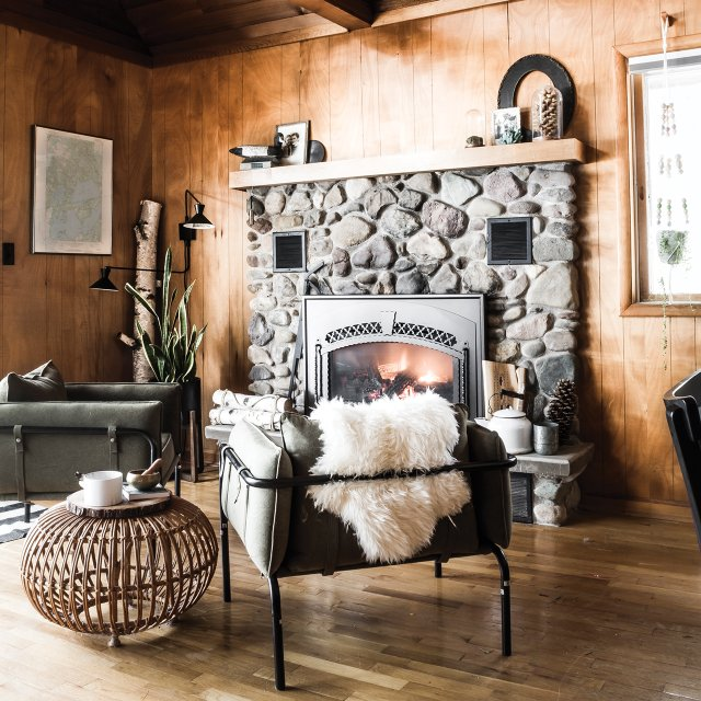 Cabin interior with stone fireplace