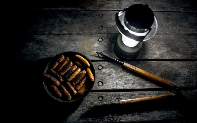 Lantern light and grilled sausages