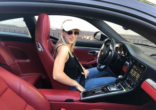 Maggie driving Porsche 911