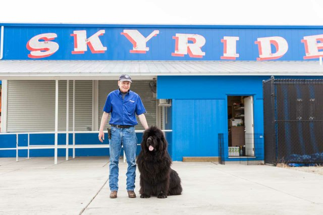 Don McClure with his dog in front of the State Fair Skyride