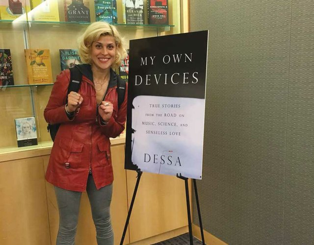 Dessa with sign for My Own Devices book