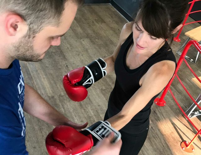 Lisa preparing for boxing class at Title Boxing