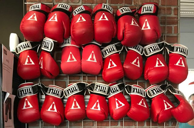 Wall of boxing gloves at Title Boxing