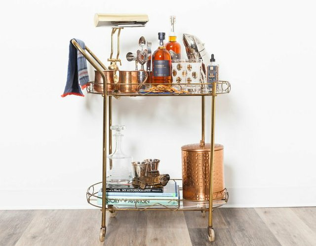 fancy cart with liquor, cups, books and ice bucket