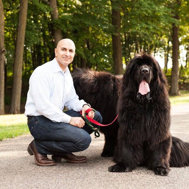 President of the Federal Reserve Bank of Minneapolis Neel Kashkari and his Newfoundland dogs