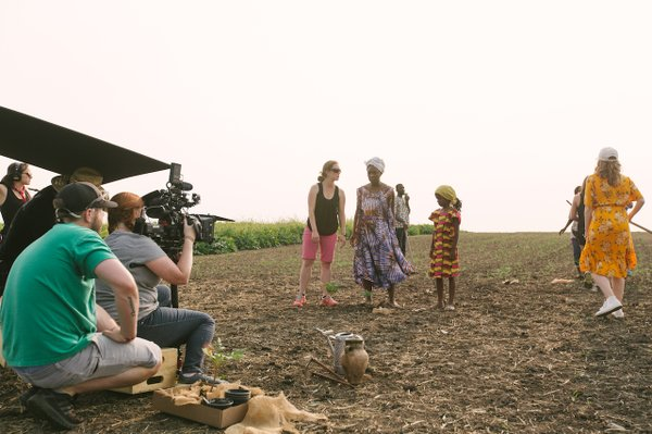 The Spark Moments cast and crew film a scene in Africa (or the Tangletown Gardens' farm).