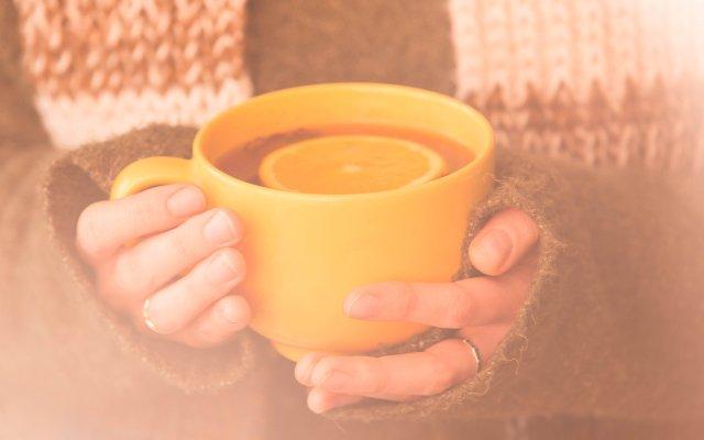 Hands holding a mug of tea