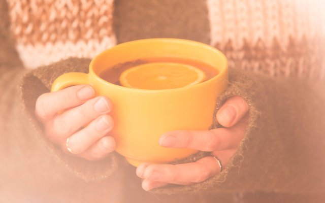 Hands holding a mug of tea